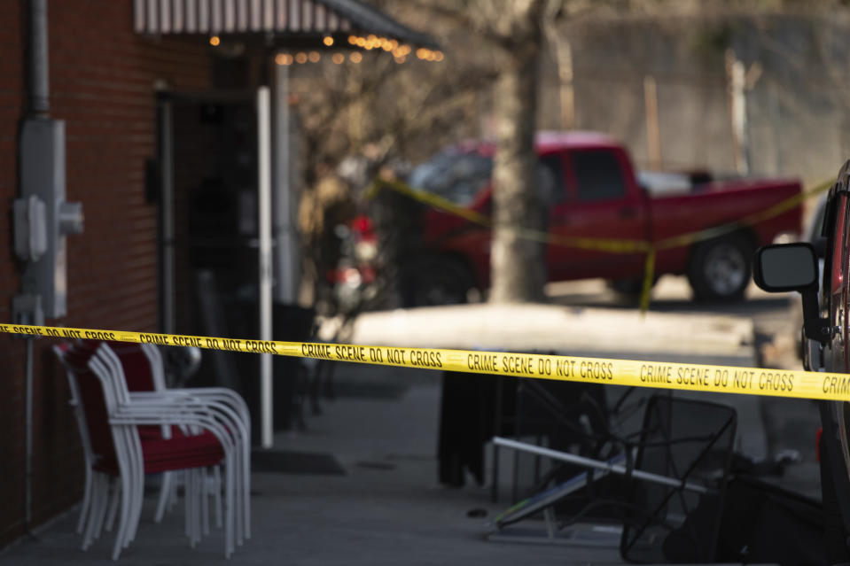 Crime scene tape stretches in front of Mac's Lounge, the scene of an early morning bar shooting, Sunday, Jan. 26, 2020, in Hartsville, S.C. (AP Photo/Sean Rayford)