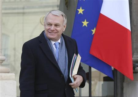 French Prime Minister Ayrault leaves the weekly cabinet meeting at the Elysee Palace in Paris