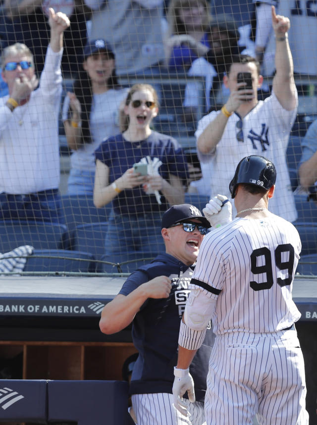 A teammate congratulates New York Yankees' Aaron Judge (99) after Judge' hit a solo home run in the eighth inning of a baseball game against the Chicago White Sox, Saturday, April 13, 2019, in New York. (AP Photo/Kathy Willens)