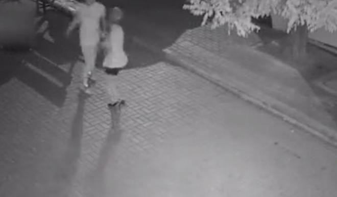 A still image from the surveillance camera footage, just before the woman is attacked. Internet sleuths were able to identify the location based on clues in the background. Photo: The Paper