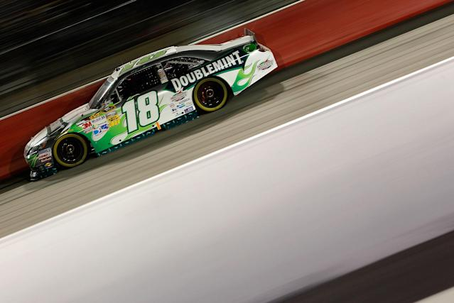 DARLINGTON, SC - MAY 12: Kyle Busch, driver of the #18 Wrigley Toyota, races during the NASCAR Sprint Cup Series Bojangles' Southern 500 at Darlington Raceway on May 12, 2012 in Darlington, South Carolina. (Photo by Geoff Burke/Getty Images for NASCAR)