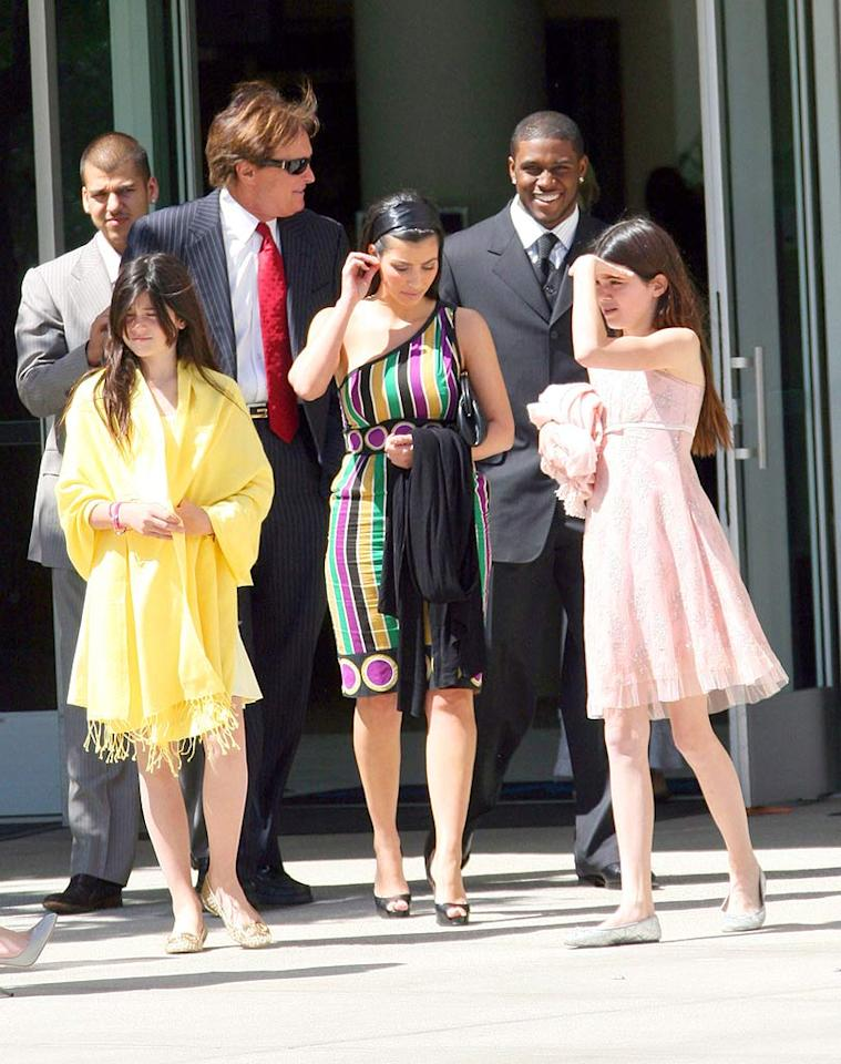 "The couple was joined by the rest of Kim's family, including her stepdad, Olympian Bruce Jenner. Interestingly enough, the Kardashians reside in Calabasas, California, but drove 25 miles to attend services in West Hollywood. Could they have been looking for a photo op? <a href=""http://www.infdaily.com"" target=""new"">INFDaily.com</a> - March 23, 2008"