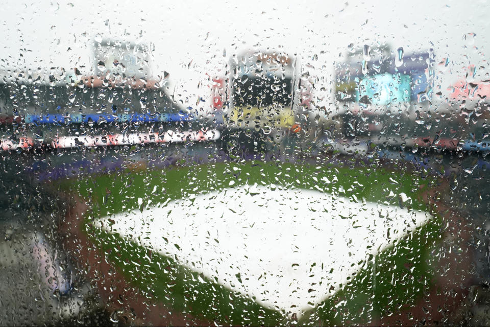 Raindrops cover a plastic baffle in the upper deck at Citi Field after a baseball game between the New York Mets and the Philadelphia Phillies was postponed due to rainy weather, Monday, April 12, 2021, in New York. Monday night's game will be rescheduled as the first game of a single-admission doubleheader, tomorrow, Tuesday, April 13, at 4:10 p.m. (AP Photo/Kathy Willens)