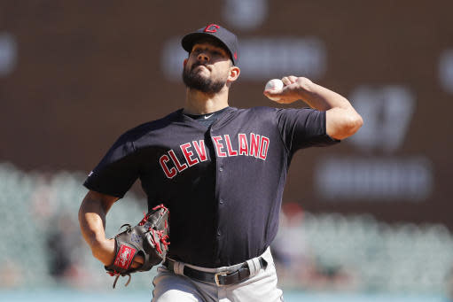 FILE - In this Aug. 29, 2019, file photo, Cleveland Indians relief pitcher Brad Hand throws during the ninth inning of a baseball game against the Detroit Tigers in Detroit. The Indians brought up highly touted reliever James Karinchak for their biggest series this season while they wait for All-Star closer Hand to get healthy. (AP Photo/Carlos Osorio, File)