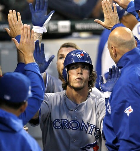 Toronto Blue Jays' Colby Rasmus is greeted in the dugout after hitting a two-run home run off Chicago White Sox starting pitcher Philip Humber during the fifth inning of a baseball game, Tuesday, June 5, 2012 in Chicago. (AP Photo/Charles Rex Arbogast)