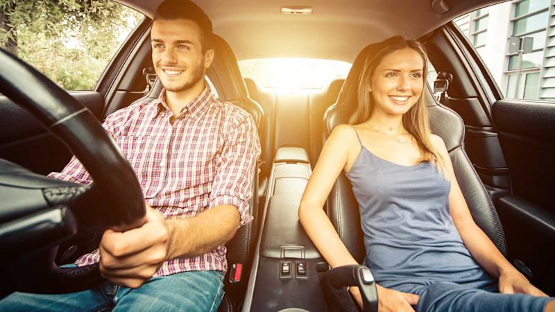 Couple driving without wearing seatbelts