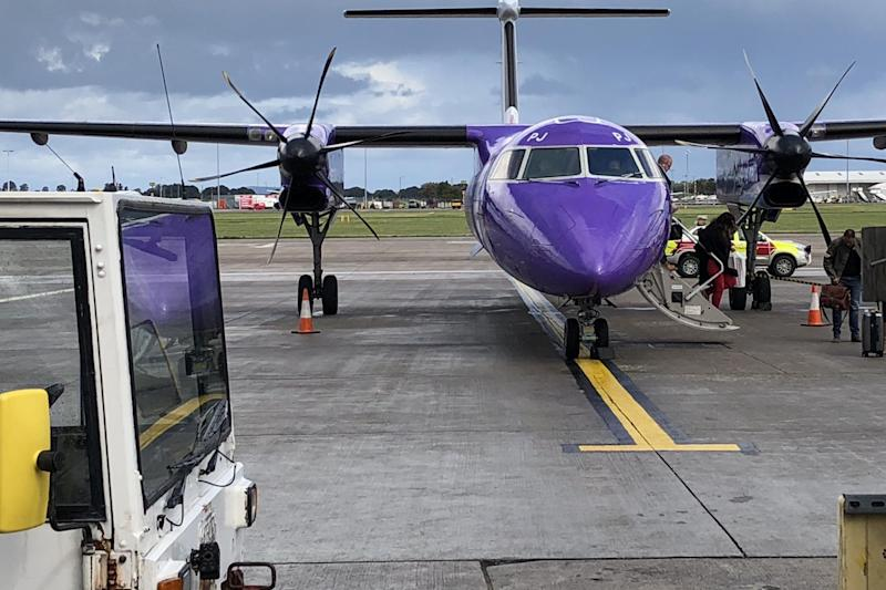 Purple patch: a Flybe Q400, just arrived at Edinburgh airport: Simon Calder