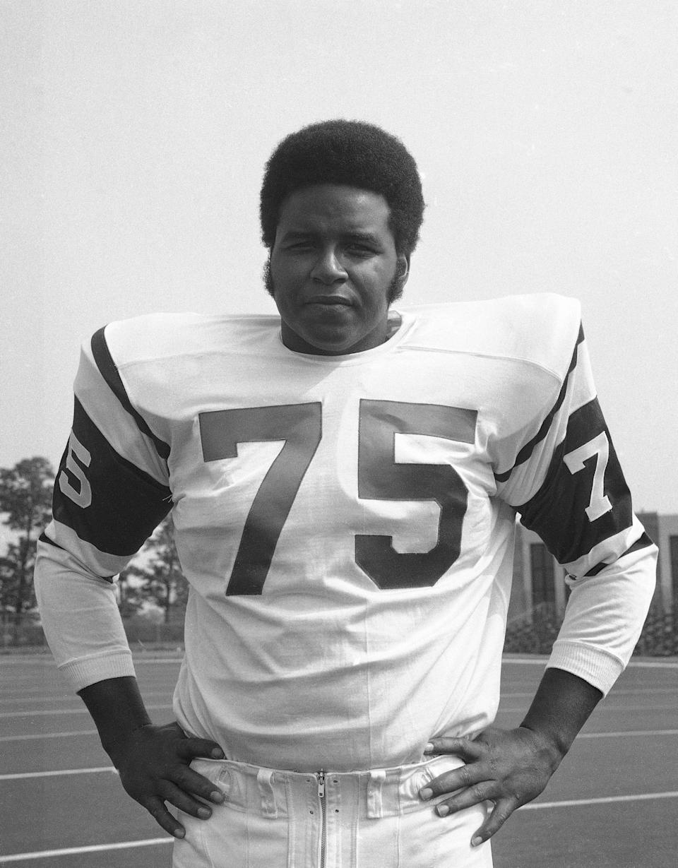 FILE - This is an August 1970 file photo showing New York Jets NFL football player Winston Hill. The 6-foot-4, 270-pound Hill certainly was easy to like off the field because of his affable, teddy bear-like personality. He also was a fierce and dependable presence on it. The late Hill, who died in 2016, was posthumously selected last year for the centennial class of the Pro Football Hall of Fame. (AP Photo/File)