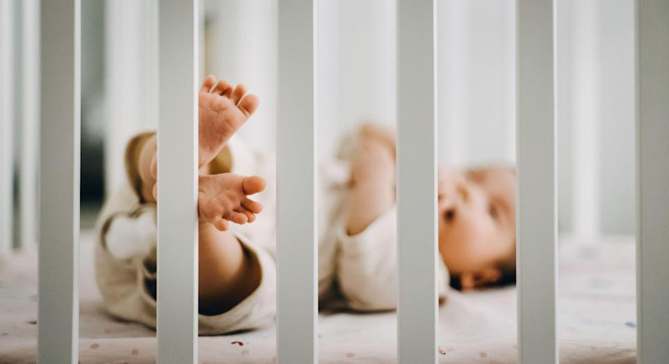 Parents have been warned after the deaths of ten children using a particular portable cot [Image: Getty]