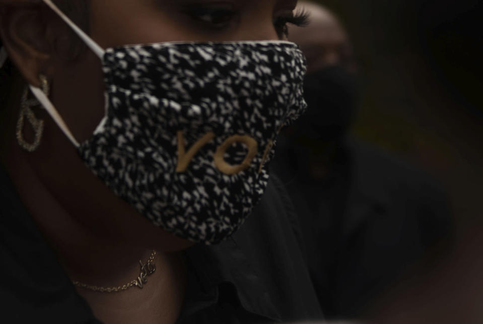 """Lizzo wears a neckless saying """"vote"""" during a campaign event in Detroit for Democratic Presidential Candidate Joe Biden and Kamala Harris on Friday Oct. 23, 2020 in Detroit. (Nicole Hester/Ann Arbor News via AP)"""