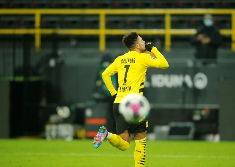 Dortmund winger Jadon Sancho celebrates scoring in Sunday's 2-0 win over Wolfsburg