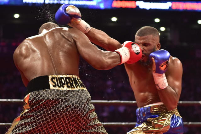 Adonis Stevenson, left, and Badou Jack exchange blows during the WBC light heavyweight championship boxing match in Toronto on Saturday, May 19, 2018. (Frank Gunn/The Canadian Press via AP)