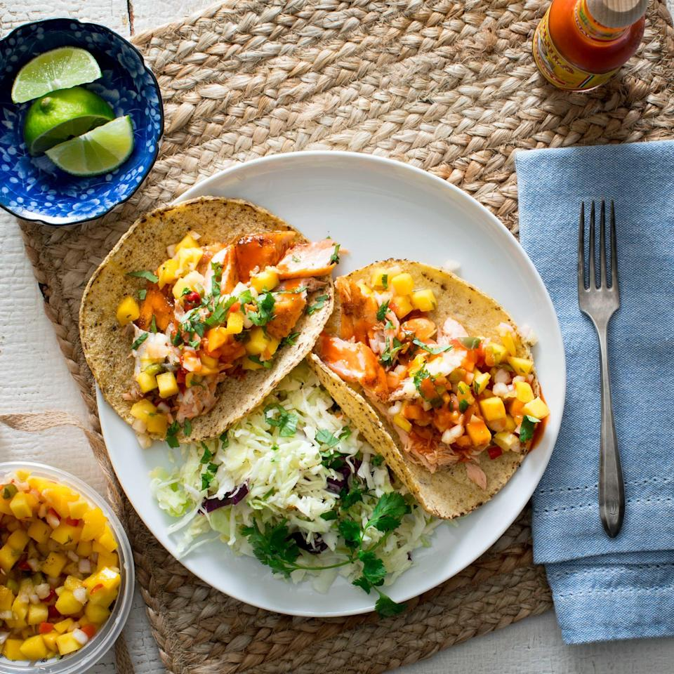 <p>An easy-to-make slaw served on the side of these salmon tacos makes for a filling and fast weeknight dinner. If you prefer more heat in these fish tacos, simply add a pinch or two of chipotle chile powder or cayenne with the chili powder.</p>