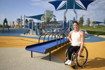 U.S. Paralympic medalist Tatyana McFadden celebrates the opening of Liberty Playground, a universally accessible playground that allows children with and without disabilities to play together in a variety of outdoor experiences; Unveiled by Liberty Mutual Insurance and the City of Plano, TX, at Windhaven Meadows Park. (Cooper Neill/Getty Images)