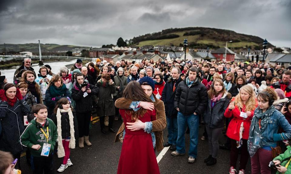 Actors from Theatr Genedlaethol Cymru (the Welsh language National Theatre of Wales ) performing in 'Y Bont' (The Bridge) through the streets of Aberystwyth in 2013, marking the 50th anniversary of the first protest for equal rights for the Welsh language.