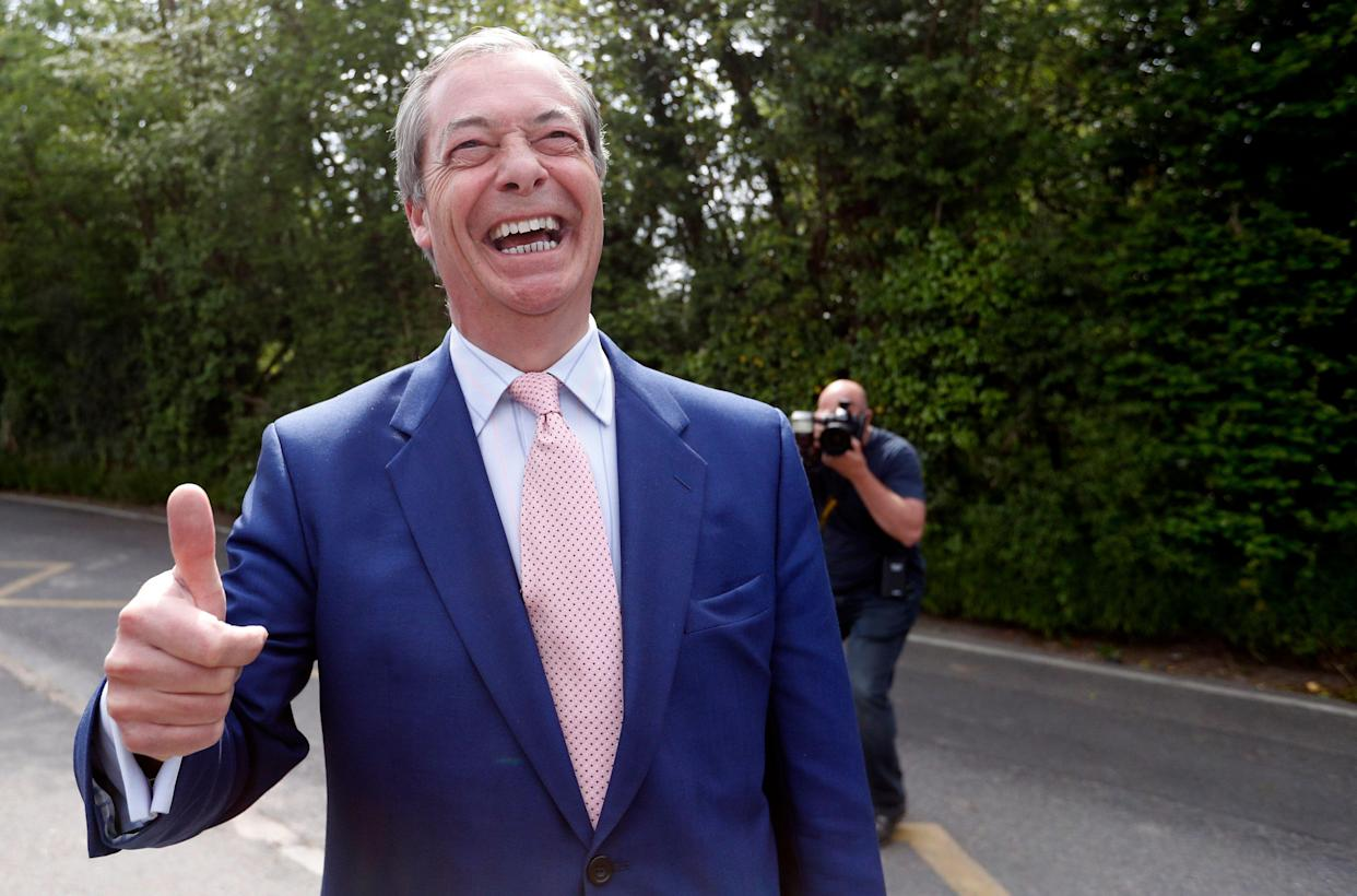 Brexit Party leader Nigel Farage gives the thumbs up to the media outside the polling station at Cudham Primary School in Biggin Hill, England, Thursday, May 23, 2019. Some 400 million Europeans from 28 countries head to the polls from Thursday to Sunday to choose their representatives at the European Parliament for the next five years. (AP Photo/Alastair Grant)