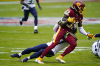 Washington Football Team wide receiver Cam Sims (89) is stopped by Seattle Seahawks free safety Quandre Diggs (37) during the first half of an NFL football game, Sunday, Dec. 20, 2020, in Landover, Md. (AP Photo/Susan Walsh)