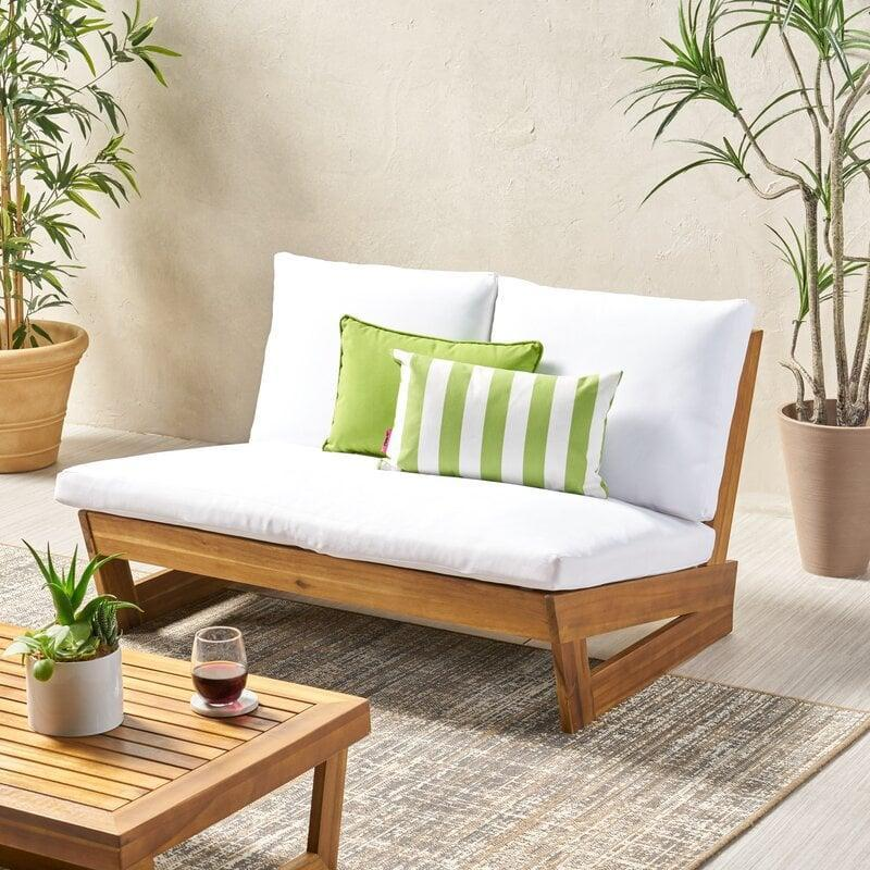 <p>This <span>AllModern Loveseat with Cushions</span> ($290) is a great option if you're dealing with a smaller space.</p>