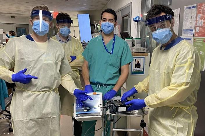 Dr. Hooman Poor, rights, stands with colleagues at Mount Sinai hospital in New York, where he is trying clot-busting drugs on COVID-19 patients.