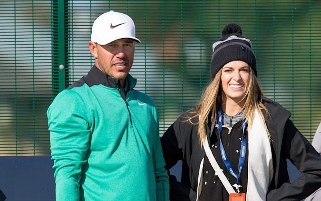 Brooks Koepka with his girlfriend, Jena Sims, during a practice round at Dunhill Links Championship - Action Plus