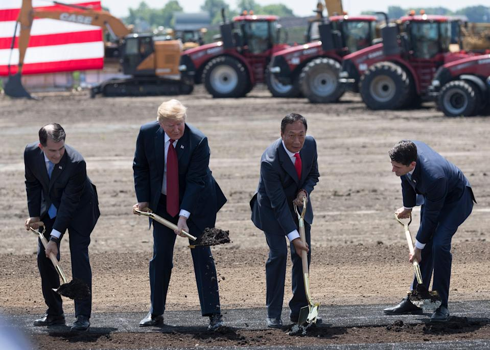 President Donald Trump (second from left) is joined by Gov. Scott Walker (left), Foxconn Chairman Terry Gou and House Speaker Paul Ryan (right) June 28, 2018, during the ceremonial groundbreaking for Foxconn's factory in Mount Pleasant.
