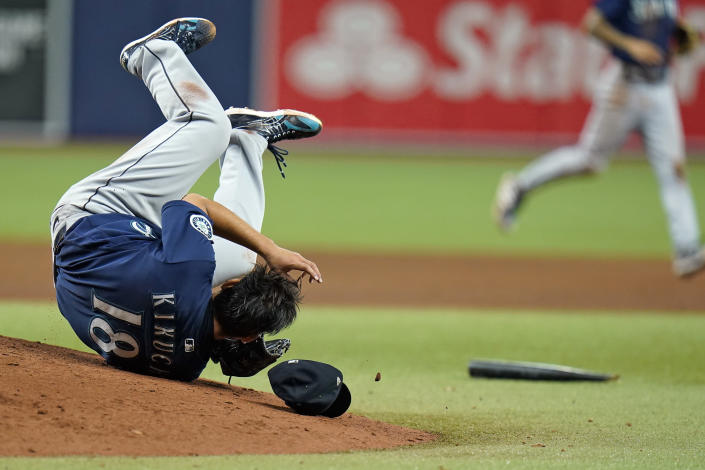 Seattle Mariners starting pitcher Yusei Kikuchi , of Japan, dives out of the way of a broken bat from Tampa Bay Rays' Nelson Cruz during the fifth inning of a baseball game Tuesday, Aug. 3, 2021, in St. Petersburg, Fla. (AP Photo/Chris O'Meara)