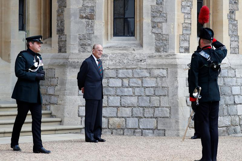 Britain's Prince Philip (C), Duke of Edinburgh flanked by Assistant Colonel Commandant, Major General Tom Copinger-Symeas (L) takes part in the transfer of the Colonel-in-Chief of The Rifles at Windsor castle in Windsor on July 22, 2020. - Britain's Prince Philip, Duke of Edinburgh will step down from his role as Colonel-in-Chief for the Rifles after 67 years of service. (Photo by Adrian DENNIS / POOL / AFP) (Photo by ADRIAN DENNIS/POOL/AFP via Getty Images)