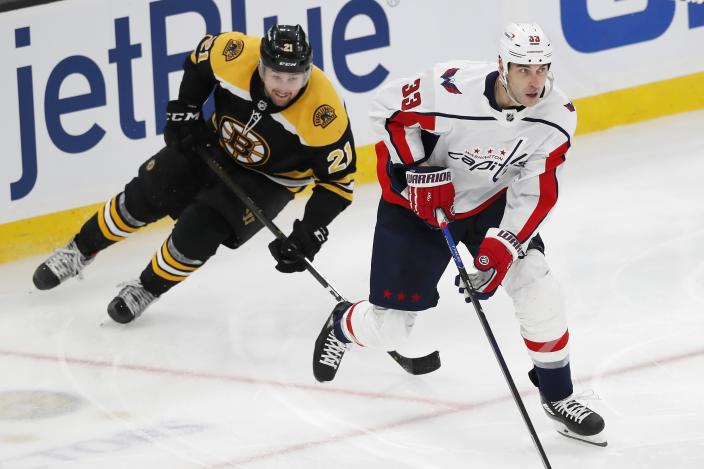 FILE - Washington Capitals' Zdeno Chara (33) defends against Boston Bruins' Nick Ritchie during the second period of an NHL hockey game in Boston, in this Sunday, April 11, 2021, file photo. The Boston Bruins and Washington Capitals already have bad blood built up going into their first-round playoff series that starts Saturday night, May 15. (AP Photo/Michael Dwyer, File)