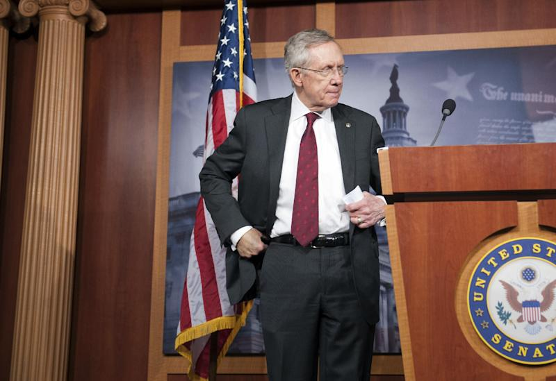 Senate Majority Leader Harry Reid, D-Nev., prepares to speak with reporters about the federal budget on Capitol Hill in Washington, Thursday, March 14, 2013. (AP Photo/Cliff Owen)