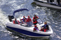 FILE - In this Feb. 5, 2021, file photo, Tampa Bay Buccaneers fans travel by boat along the Hillsborough River in Tampa, Fla. The city is hosting Sunday's Super Bowl 55 football game between the Tampa Bay Buccaneers and the Kansas City Chiefs. (AP Photo/Charlie Riedel, File)