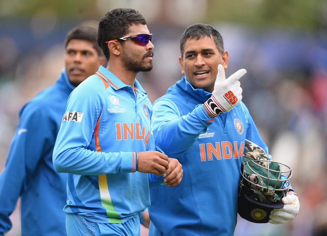 LONDON, ENGLAND - JUNE 11:  Ravrinda Jadeja of India walks off with skipper Mahendra Singh Dhoni during the ICC Champions Trophy Group B match between India and West Indies  at The Kia Oval on June 11, 2013 in London, England.  (Photo by Mike Hewitt/Getty Images)