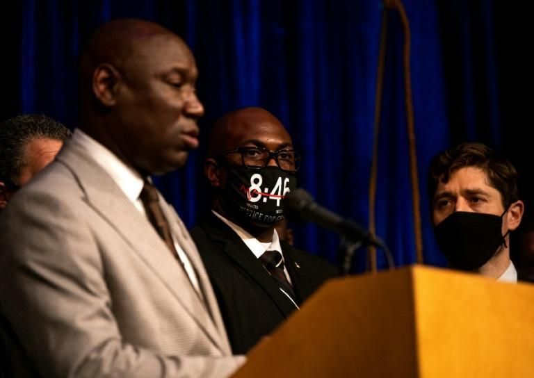 Attorney Ben Crump (L) announces that the city of Minneapolis has reached a $27 million settlement with the family of George Floyd as Floyd's brother Philonise (C) and Mayor Jacob Frey (R) look on