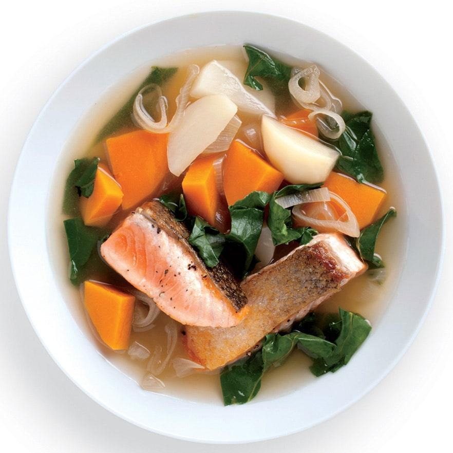 """This light but richly flavored broth is good with any fatty, skin-on fish fillet, such as Arctic char or sea bass. Root vegetables fill out the satisfying bowl. <a href=""""https://www.epicurious.com/recipes/food/views/seared-salmon-with-winter-vegetables-and-kombu-broth-51214620?mbid=synd_yahoo_rss"""" rel=""""nofollow noopener"""" target=""""_blank"""" data-ylk=""""slk:See recipe."""" class=""""link rapid-noclick-resp"""">See recipe.</a>"""