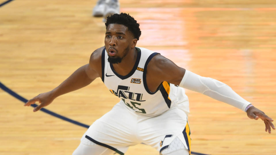 Utah Jazz guard Donovan Mitchell defends the Memphis Grizzlies during the second half of Game 3 of an NBA basketball first-round playoff series Saturday, May 29, 2021, in Memphis, Tenn. (AP Photo/John Amis)