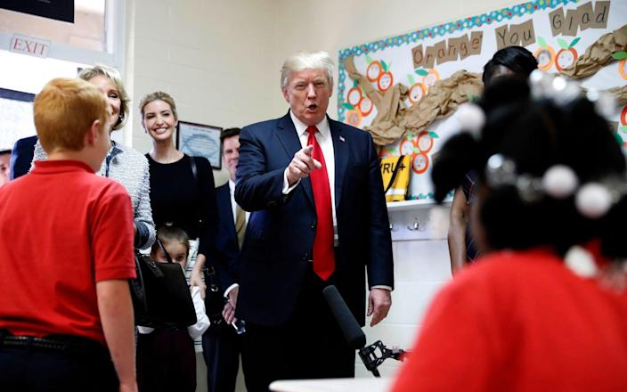 Donald Trump meets children at Saint Andrew Catholic School - Copyright 2017 The Associated Press. All rights reserved.