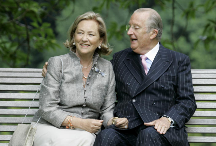 FILE - In this Tuesday, July 17, 2008 file photo, Belgium's Queen Paola and King Albert II pose for photographers at the Royal Palace in Laeken, Belgium. Belgium's royal scandal that has riveted the nation and damaged those involved reached a new milestone when former King Albert II reunited with the daughter he fathered out of wedlock over half a century ago. Capping a momentous few weeks, Albert II, and his wife Queen Paola met the former Delphine Boel, who is now recognized as Her Royal Highness Princess Delphine after a bitter two-decade paternity fight. (AP PhotoVirginia Mayo, File)