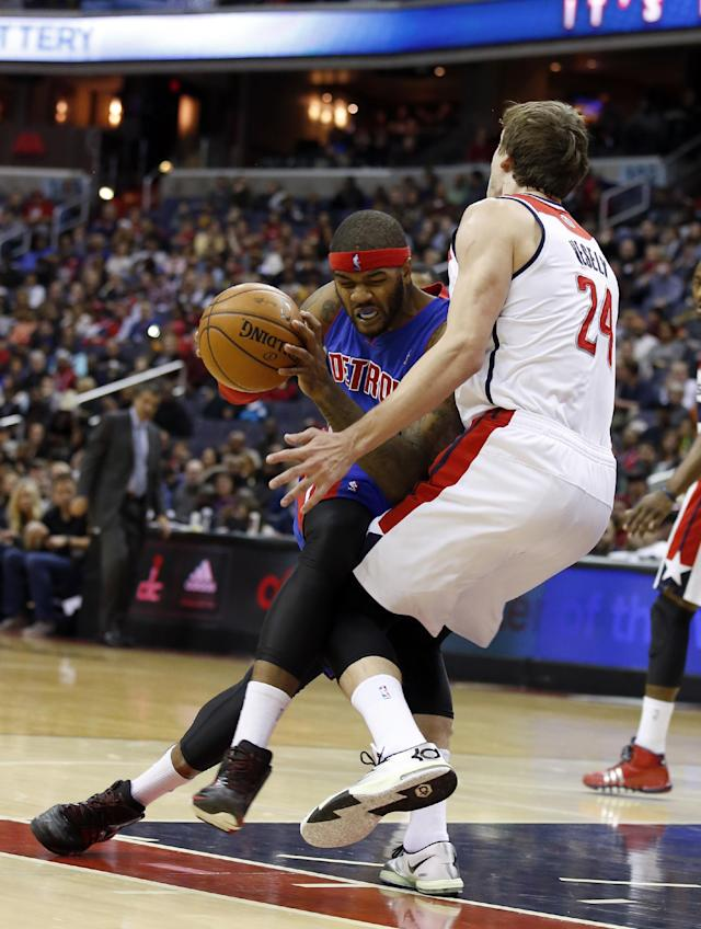 Detroit Pistons forward Josh Smith (6) is fouled by Washington Wizards forward Jan Vesely (24), from the Czech Republic, in the first half of an NBA basketball game, Saturday, Jan. 18, 2014, in Washington. (AP Photo/Alex Brandon)