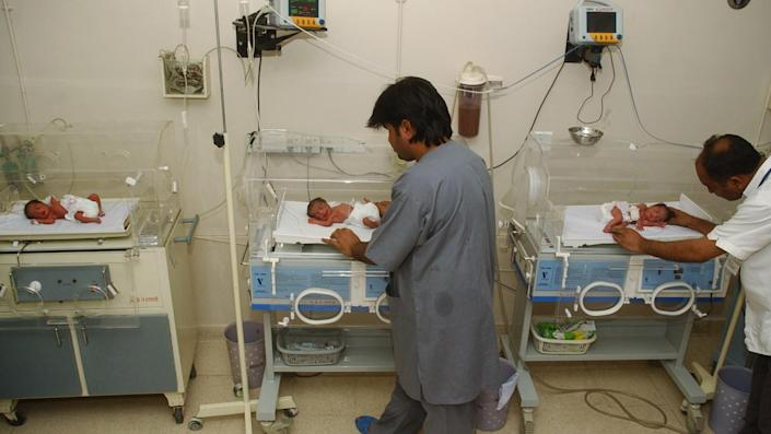 FILE - In this file photo taken Wednesday, Oct. 4, 2006, Pakistani hospital staff members attend newly born babies in Karachi, Pakistan. Anita Zaidi, a Pakistani doctor, won a $1 million grant Tuesday, Dec. 10, 2013, to fight early child mortality in a small fishing village in southern Pakistan in a contest financed by an American entrepreneur to find innovative ways to save lives, The Caplow Children's Prize said. (AP Photo/Shakil Adil, File)