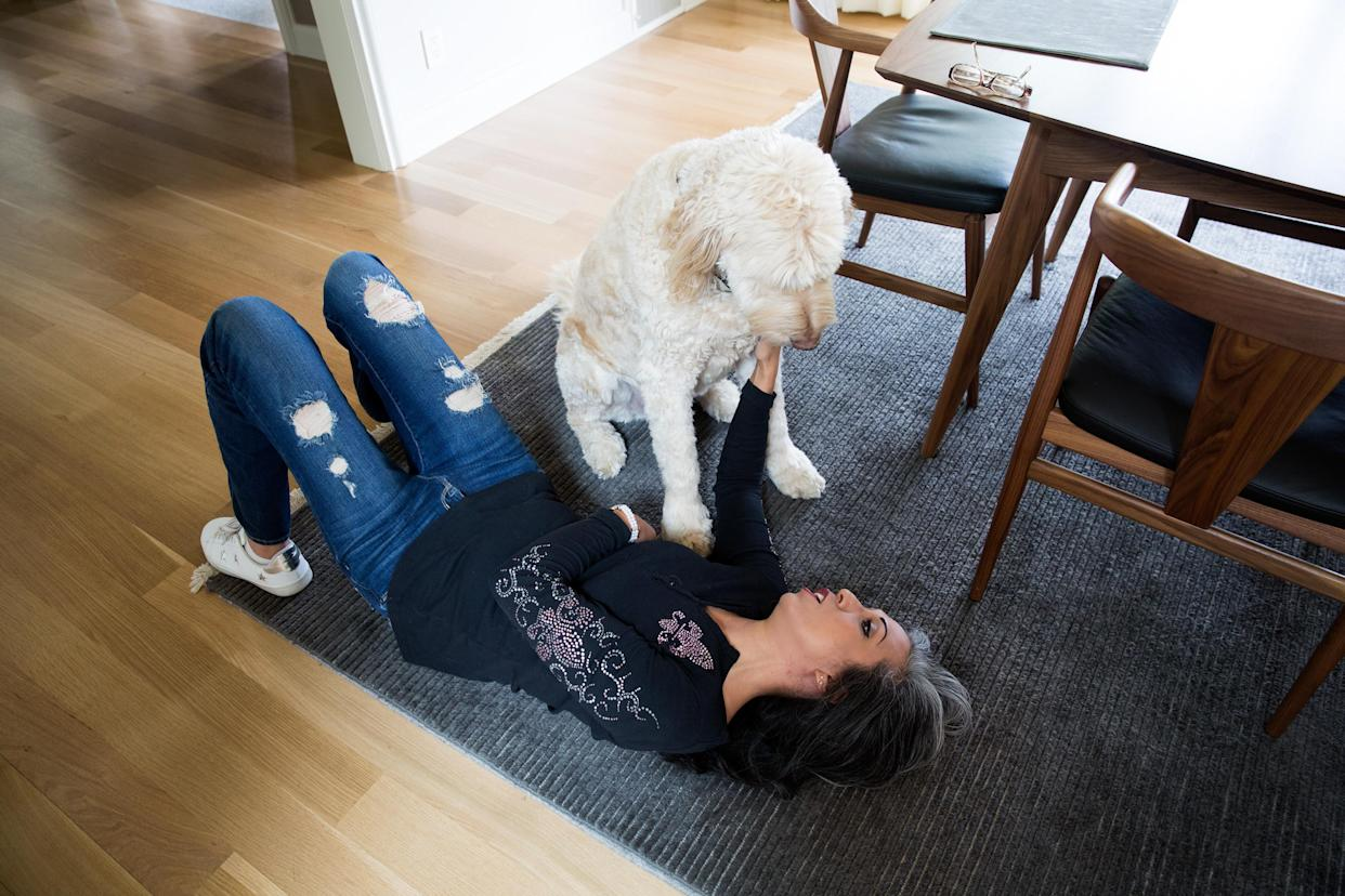 Gina Aparicio plays with Cosmo, the Matts' dog, during her visit to their home, on June 24, 2018, in Providence, R.I. (Photo: Kayana Szymczak for Yahoo News)