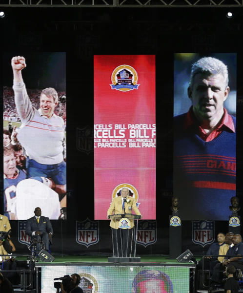 Former NFL football head coach Bill Parcells speaks during the induction ceremony at the Pro Football Hall of Fame Saturday, Aug. 3, 2013, in Canton, Ohio. (AP Photo/Tony Dejak)