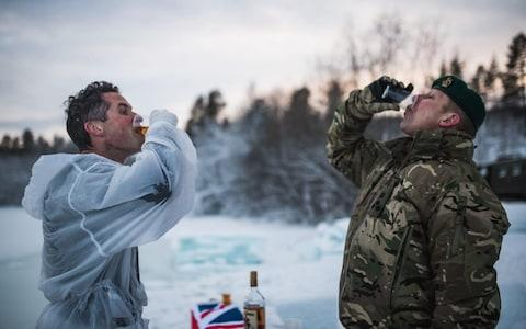 Defence Secretary Gavin Williamson drinks rum after doing the ice breaking drills in Bardufoss, Norway17 February 2019 - Credit:  MoD