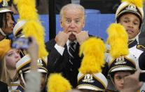 Standing amid members of the Euclid High School marching Band, Vice-President Joe Biden whistles to get someone's attention following a campaign stop at a fire station in Euclid, Ohio, Tuesday, Nov. 15, 2011. (AP Photo/Amy Sancetta)