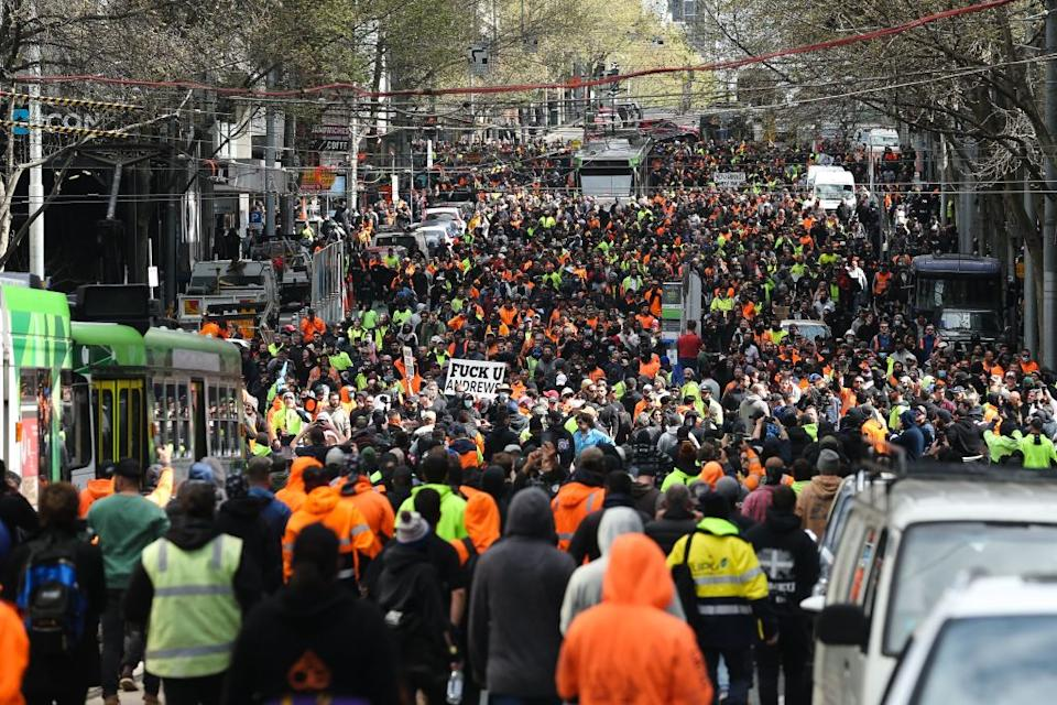 Construction workers and demonstrators protest against Covid-19 regulations in Melbourne. Photo: Getty