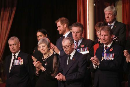 Britain's Prince Andrew, Duke of York, Prime Minister Theresa May with husband Philip May, Meghan, Duchess of Sussex and Prince Harry, Duke of Sussex attend the Royal British Legion Festival of Remembrance to commemorate all those who have lost their lives in conflicts and mark 100 years since the end of the First World War, at the Royal Albert Hall, London, Britain November 10, 2018. Chris Jackson/Pool via REUTERS