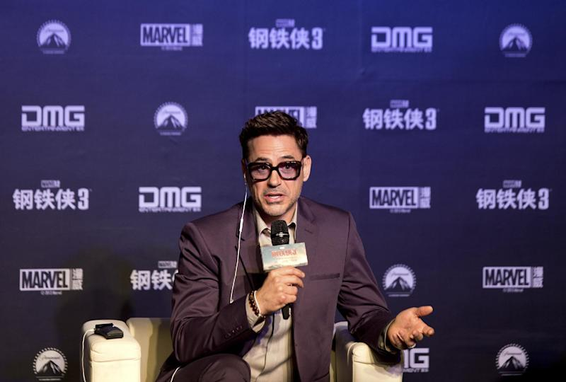 """U.S. actor Robert Downey Jr. speaks during a world premiere event of his new movie """"Iron Man 3"""" at a Beijing hotel Saturday, April 6, 2013. (AP Photo/Andy Wong)"""