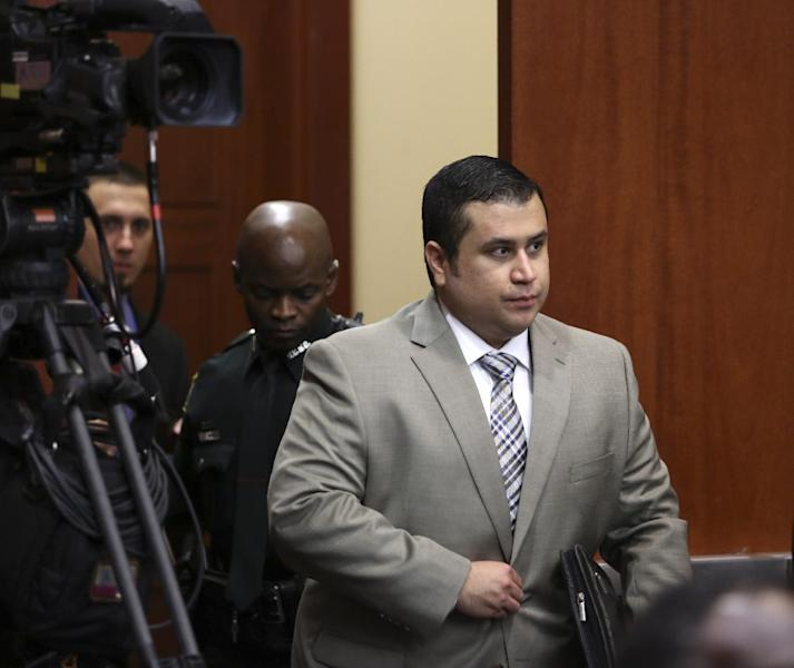 George Zimmerman enters the courtroom for his trial in Seminole County circuit court in Sanford, Fla. Tuesday, June 25, 2013. Zimmerman has been charged with second-degree murder for the 2012 shooting death of Trayvon Martin.(AP Photo/Orlando Sentinel, Gary W. Green, Pool)