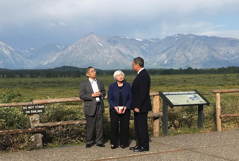 Fed Chair Janet Yellen, talks with Mario Draghi, head of the ECB, and Haruhiko Kuroda, head of the BoJ, during a break at the central bankers conference at Jackson Hole, Wyo., Friday, Aug. 25, 2017. (AP Photo/Martin Crutsinger)