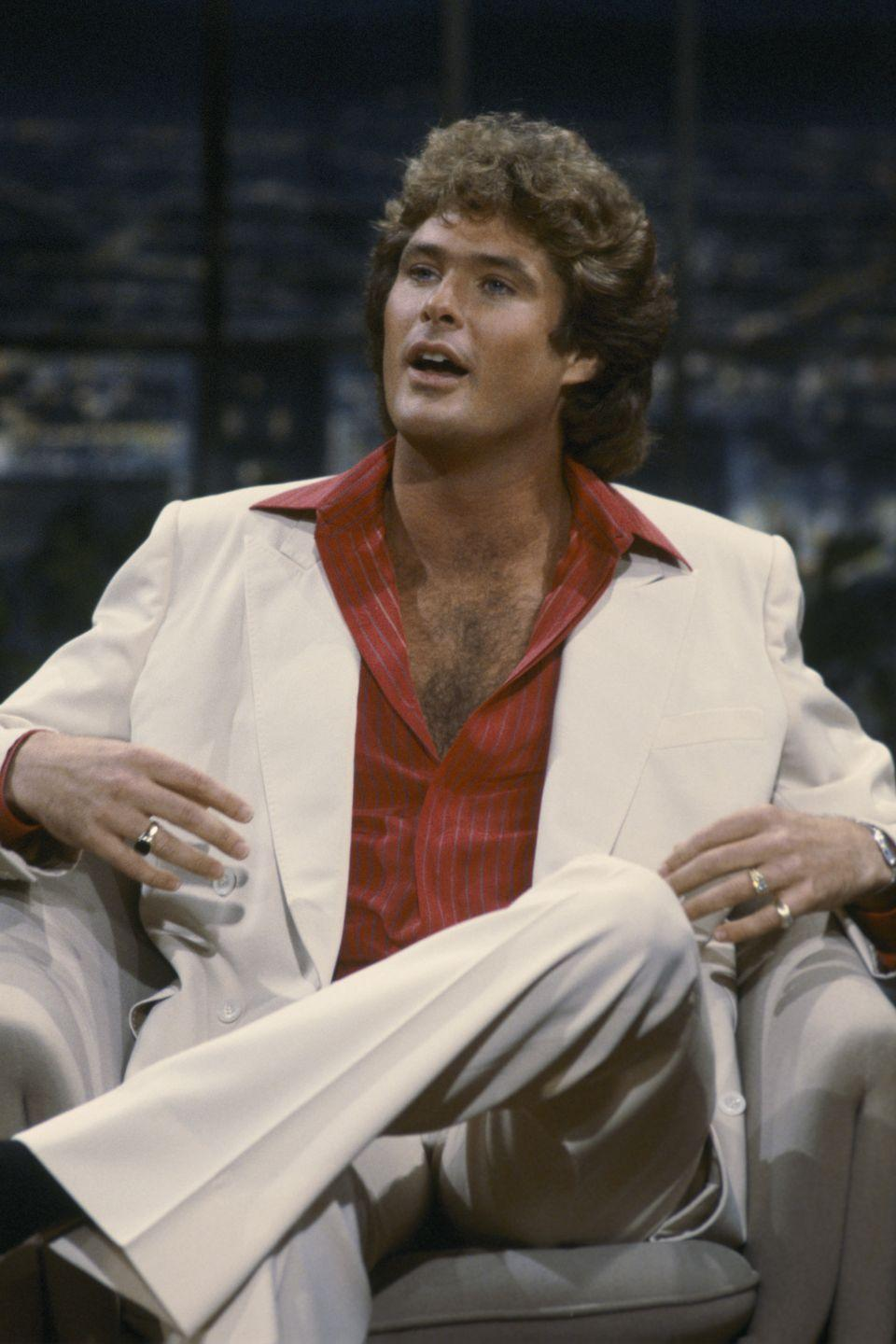 <p>You could say that David Hasselhoff is the godfather of hairy chests. In the '80s, the actor made the open collar look his signature on shows like <em>Knight Rider </em>and <em>Baywatch</em>. </p>