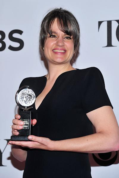 """Pam MacKinnon poses with her award for best direction of a play for """"Who's Afraid of Virginia Woolf?"""" in the press room at the 67th Annual Tony Awards, on Sunday, June 9, 2013 in New York. (Photo by Charles Sykes/Invision/AP)"""