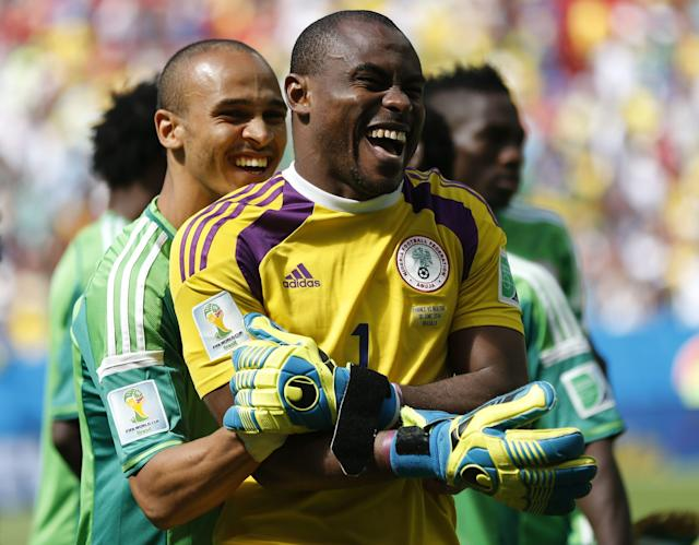 Nigeria's Emmanuel Emenike (L) shares a moment with teammate Vincent Enyeama before the start of their 2014 World Cup round of 16 game against France at the Brasilia national stadium in Brasilia June 30, 2014. REUTERS/Ueslei Marcelino (BRAZIL - Tags: SOCCER SPORT WORLD CUP)